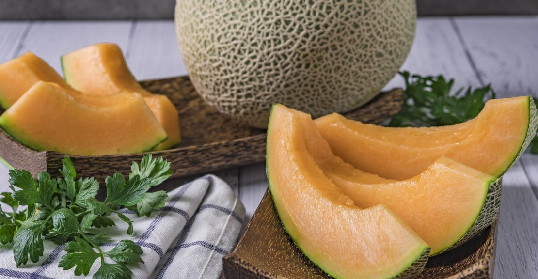 Whole and sliced of Japanese melons,honey melon or cantaloupe (Cucumis melo) Glass Of Melon Smoothie